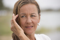 Confident attractive mature woman outdoor Stock Photography