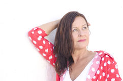 Confident attractive mature woman white background Stock Photo