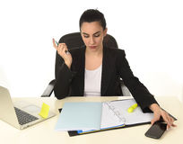 Confident attractive woman in formal suit working in stress focused and concentrated Royalty Free Stock Image