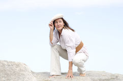 Confident attractive woman outdoor white background Stock Image