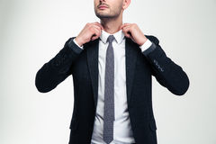 Confident attractive young businessman adjusting his collar Royalty Free Stock Image