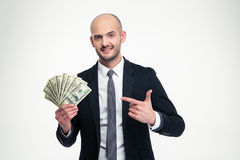 Confident attractive young businessman holding and pointing on money Stock Images