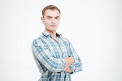 Confident attractive young man standing with arms crossed. Over white background Stock Images