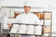 Confident Baker Holding Baking Tray Royalty Free Stock Photo