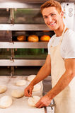 Confident baker at work. Stock Images
