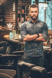Confident barber expert. Royalty Free Stock Images