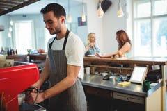 Confident barista using espresso maker at coffee shop Stock Photography