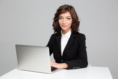 Confident beautiful business woman working using laptop Stock Images