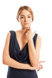 Confident and beautiful female model touching her face Royalty Free Stock Image