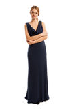 Confident and beautiful female model wearing a long dress Stock Photography