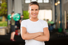 Confident and beautiful woman at fitness gym Royalty Free Stock Photography