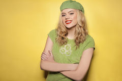 Confident beautiful woman in a green ensemble Stock Images