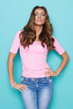 Confident Beautiful Young Woman In Pastel Pink Shirt Stock Photos