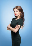 Confident, beautiful, young woman posing over isolated backgroun Stock Images