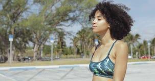 Relaxing sportive girl walking on street stock footage