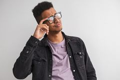 Confident black male in glasses looking away royalty free stock images