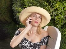 Confident blond woman on mobile phone Royalty Free Stock Photo