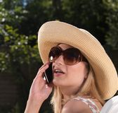 Confident blond woman on mobile phone Stock Photography