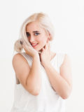 Confident blonde with big blue eyes  flirting Royalty Free Stock Photography