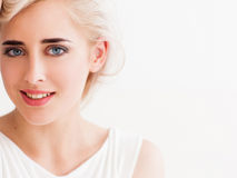 Confident blonde in white smiles Stock Photos