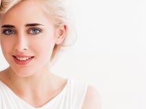 Confident blonde in white smiles Stock Photos