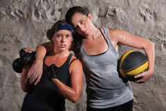Confident Boot Camp Training Partners. Strong Caucasian women with workout partner flexing her bicep Royalty Free Stock Photography