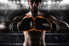 Confident boxer with fiery boxing gloves Stock Photo