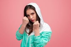 Confident boxing girl on pink stock photography