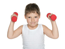 Confident boy with dumbbells Royalty Free Stock Photography
