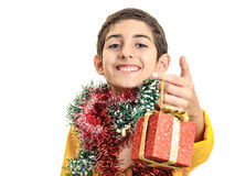 Confident boy giving Christmas gift Royalty Free Stock Photo