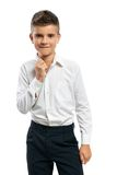 Confident boy straightens collar Stock Photography