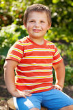 Confident boy in the striped shirt Royalty Free Stock Photo