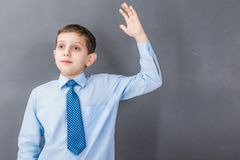 Confident boy student before dark background with copy-space Royalty Free Stock Photos
