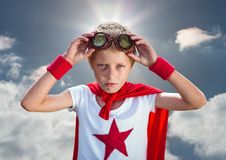 Confident boy wearing superhero costume standing against cloudy sky background. Portrait of confident boy wearing superhero costume standing against cloudy sky Stock Photography