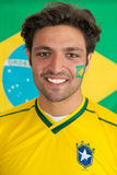 Confident Brazilian man. Confident, snug looking man in the colours of the National Brazilian soccer team Stock Photos