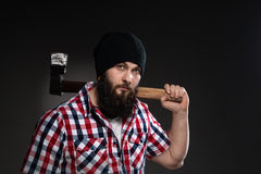 Confident, brutal bearded man with axe Stock Images