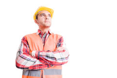 Confident builder looking up Stock Photography