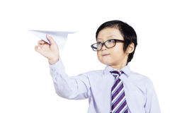 Confident business boy holding paper plane - isolated Stock Photography