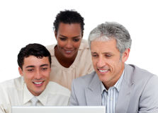 Confident business co-workers using a laptop Stock Image