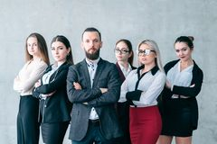 Confident business coach corporate team training. Confident business coach. Corporate advanced training. Team of company professionals posing with arms crossed royalty free stock photography