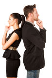 Confident business couple leaning on each other with backs, hold. Ing chin and thinking. Conceptual image royalty free stock photo