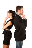 Confident business couple leaning on each other with backs, hold. Ing chin and thinking. Conceptual image royalty free stock photography