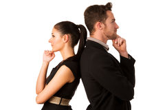 Confident business couple leaning on each other with backs, hold Royalty Free Stock Photo
