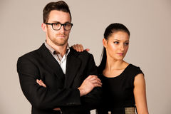 Confident business couple standing next to each other. Woman lea Stock Image
