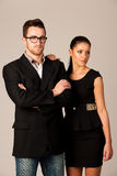 Confident business couple standing next to each other. Woman lea Stock Photography