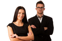 Confident business couple standing one behind the other as a sig Royalty Free Stock Images