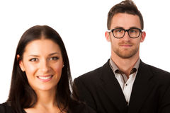 Confident business couple standing one behind the other as a sig Royalty Free Stock Photo