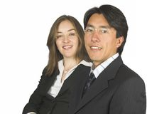 Confident business couple wearing glasses Stock Photo