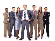 Confident business executive. With his team in the background royalty free stock image