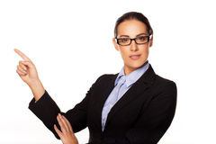 Confident business executive pointing Royalty Free Stock Photo